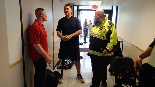 Marine Sgt. Maj. Damion Jacobs (left) and Marine Capt. Cam West visit with Boston emergency workers who responded to the bombings at the Boston Marathon. (Oren Dorell for USA Today)