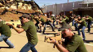 Businessmen from Philadelphia practice with wooden cutouts of rifles at Caliber 3, a counter-terrorism training center amid Israeli settlements south of Jerusalem. Millions of tourists visit Israel each year and for those interested in Israel's security, for a price they can spend a few hours learning commando techniques.