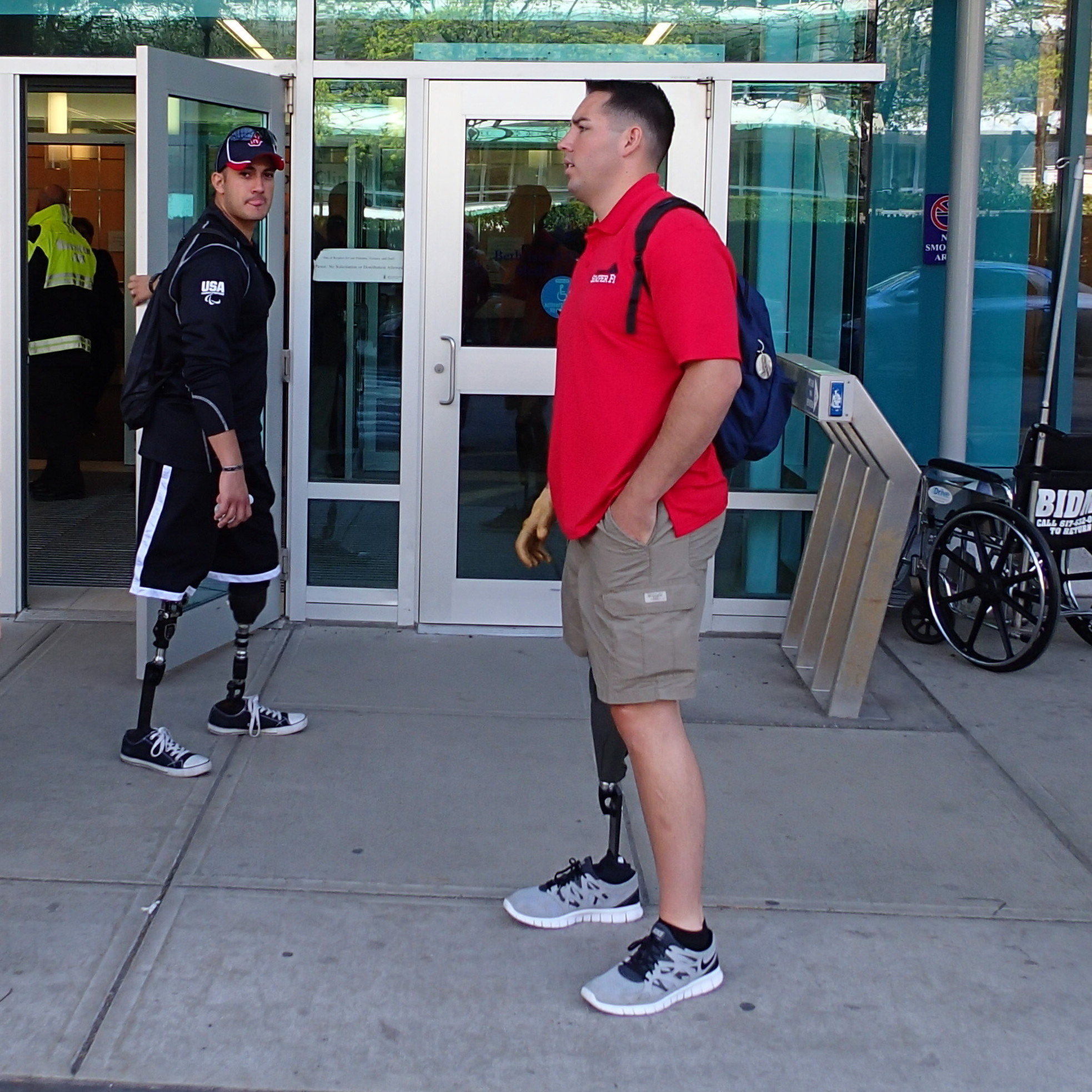 Sgt. Gabe Martinez (left) and Marine Capt. Cameron West visited amputee patients from the Boston Marathon bombing at Beth Israel Deaconess Hospital.