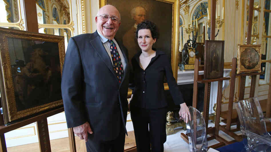 American Thomas Selldorff and Austrian art historian Sophie Lillie, who helped him identify the paintings, pose for the media during a ceremony at the Culture Ministry in Paris on March 19 to ret