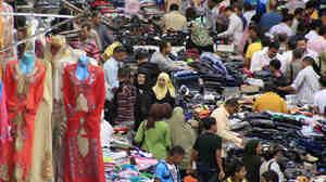 Egyptians wander through a popular market in Cairo.