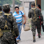 Honduran Army soldiers patrol streets in Tegucigalpa, Honduras, in April. Gang violence has many Hondurans fleeing to the U.S.