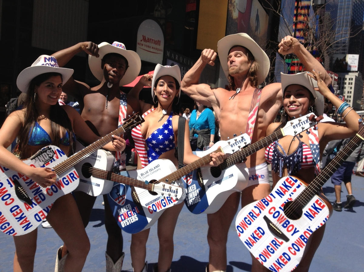 A man dressed up as a naked Cowboy in Times Square prior