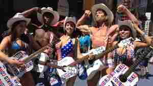 Times Square's Naked Cowboy Wrangles Some Co-Workers