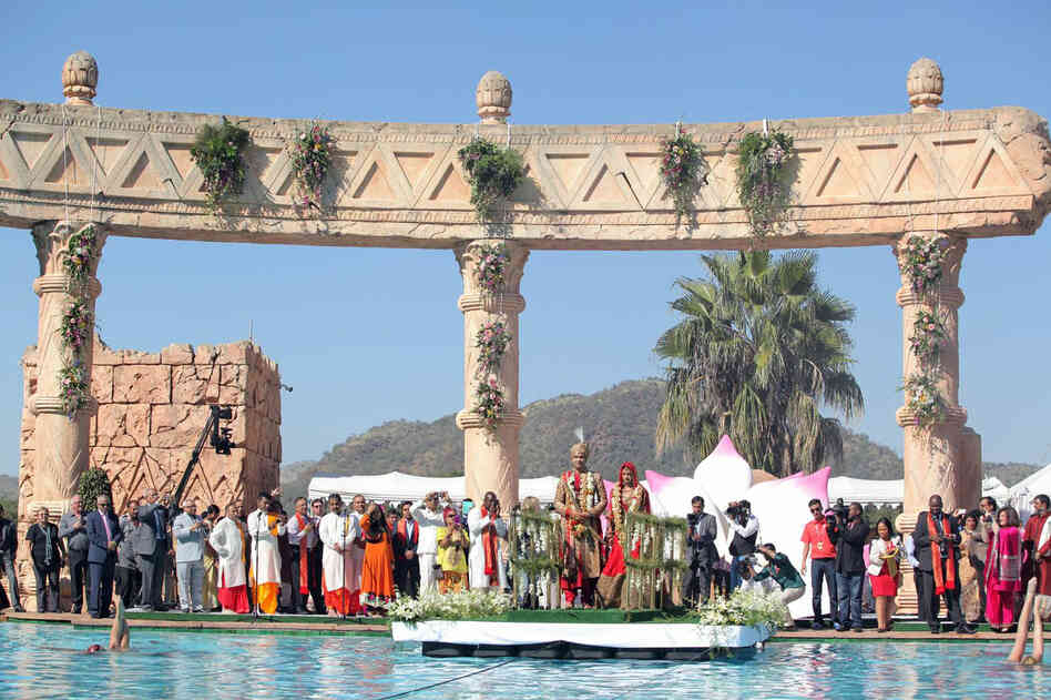 The wedding party poses at the Sun City resort in South Africa, on Wednesday. South Africa's government announced the suspension of a slew of officials and military personnel on Friday as it tried to limit the political and diplomatic fallout from the lavish Indian wedding.