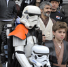 Fans are celebrating Star Wars Day today, May 4. Here, actor David Prowse (center),  who played Darth Vader in the first Star Wars trilogy, poses with costumed fans in France last week.