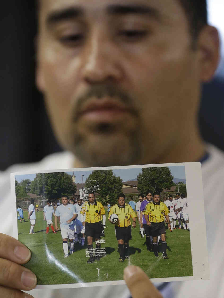 Soccer referee Ricardo Portillo died Saturday, after being struck by a player. Here, Portfillo, is seen holding a soccer ball, in a photo held by his brother-in-law, Jose Lopez, Thursday.