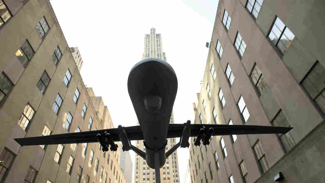 A model of a drone is hoisted in the air at a protest of the U.S. military's use of drones during a demonstration on April 3 in New York.