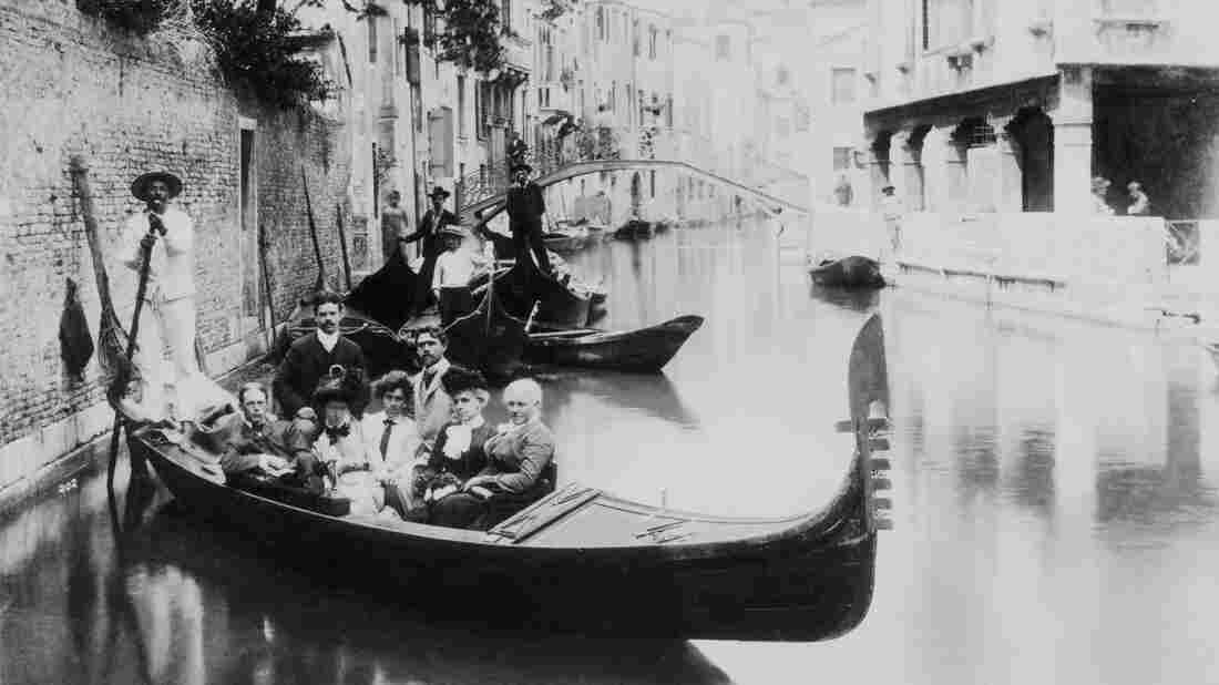 Gondolas have long played a part in the Venetian tourist experience. But as tourism has grown and the local population has declined, everyday gondolas called traghetti have all but disappeared. Above, a group of tourists poses on a canal, circa 1900.