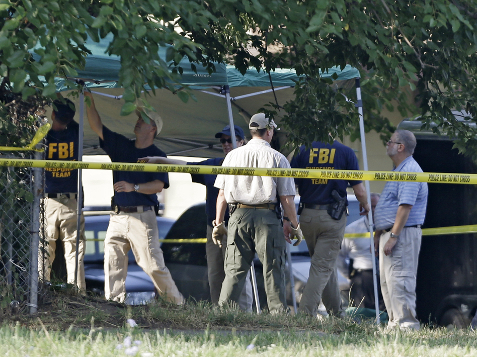 Cleveland police and FBI agents search a yard on the west side of Cleveland in July 2012 for evidence of Amanda Berry's disappearance. It turned out to be a false lead.