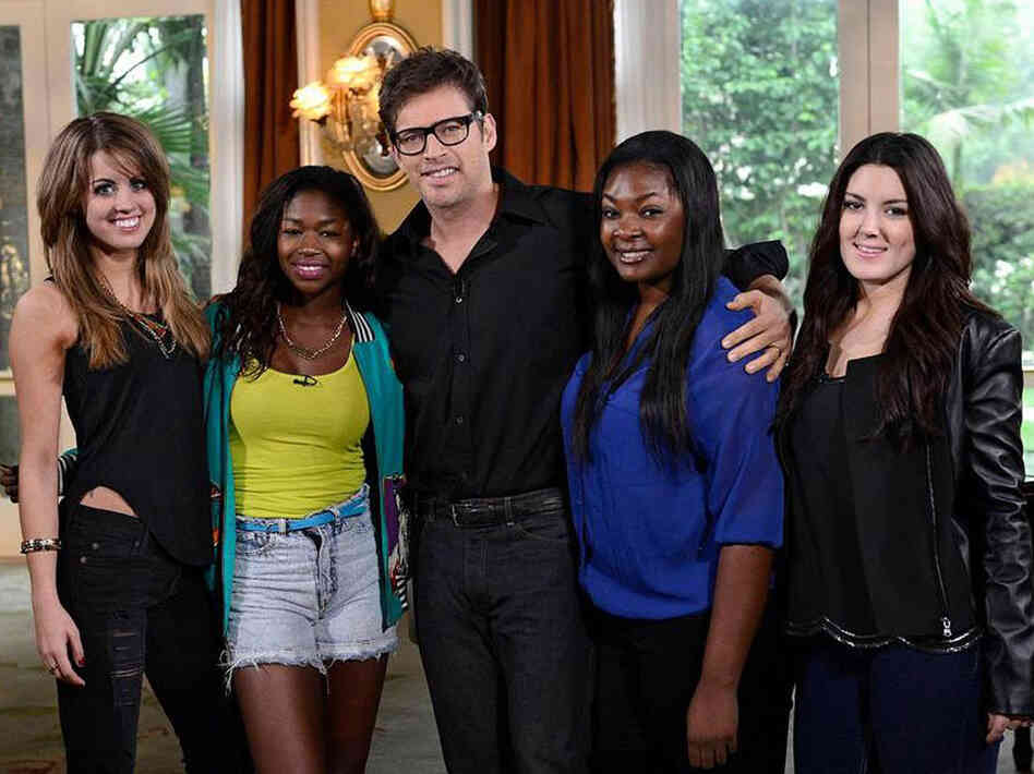 Harry Connick, Jr. (center) with the final four contestants on season 12 of American Idol. From left: Angie Miller, Amber Holcomb, Candice Glover and Kree Harrison.