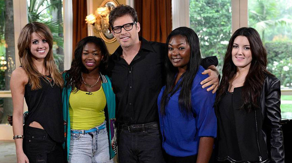 Harry Connick, Jr. (center) with the final four contestants on season 12 of American Idol. From left: Angie Miller, Amber Holcomb, Candice Glover and Kree Harrison. (FOX)