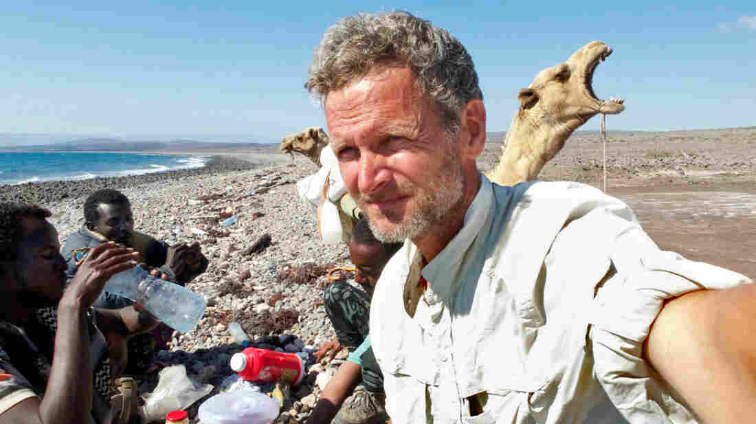 Journalist Paul Salopek reaches the Red Sea as part of his planned seven-year, 27,000-mile trek. Modaita, the yawning camel, is unimpressed.