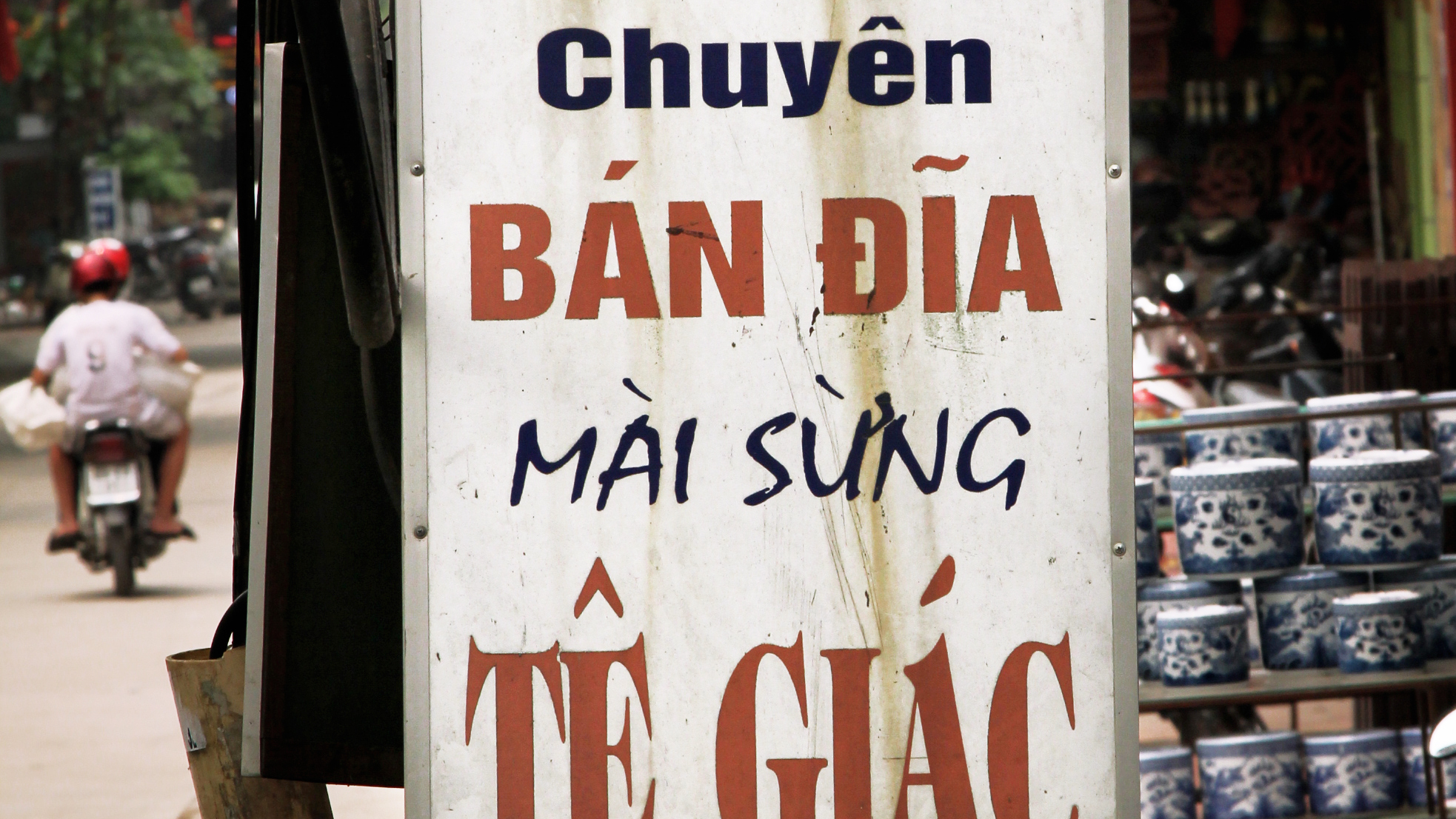 A sign for rhino horn grinding bowls in the porcelain-making village of Bat Trang, outside Hanoi. One factory owner says she sold 10,000 bowls last year.