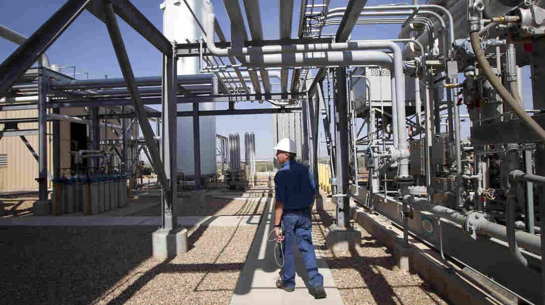 Deward Cawthon, a plant operator at the Federal Helium Reserve, walks through the Federal Crude Helium Enrichment Unit near Amarillo, Texas, in 2011.
