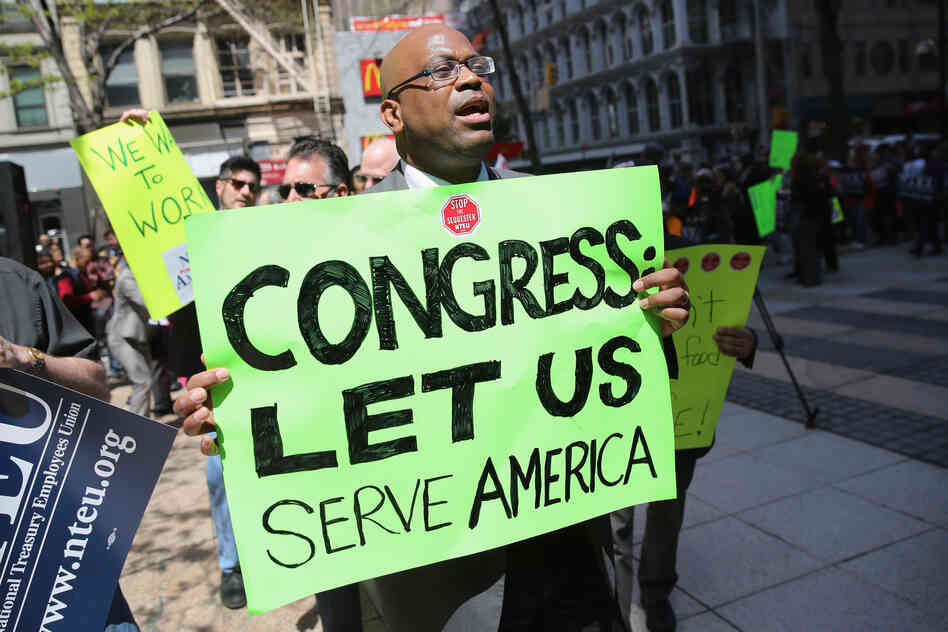 Federal employees demonstrate against the U.S. budget sequester, outside N