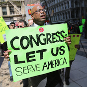 Federal employees demonstrate against the U.S. budget sequester, outside New York's Federal Plaza on Tuesday.