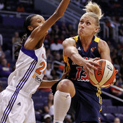 Indiana Fever guard Erin Phillips (right) drives past Phoenix Mercury forward DeWanna Bonner during the first half of their WNBA basketball game Aug. 25.