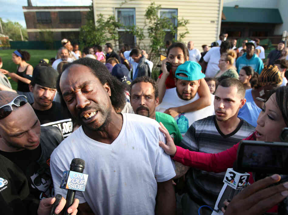 Charles Ramsey talks to media Tuesday as people congratulate him for having helped some women get out of a Cleveland home. Amanda Berry, Gina DeJesus, Michelle Knight and a 6-year-old girl were rescued from the house.
