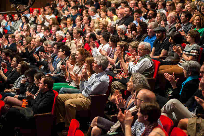 A view of the audience at New York University's The Skirball Theater, watching the live staging of Wait Wait... Don't Tell Me!'s national cinecast.
