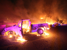 Burned cars sit on a highway in Ecatepec near Mexico City, where a gas tanker truck exploded Tuesday. The explosion caused at least 20 deaths and widespread damage in the area.