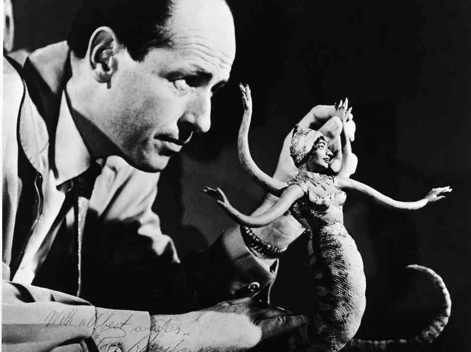 American film animator and special effects creator Ray Harryhausen with one of his creations in 1965.
