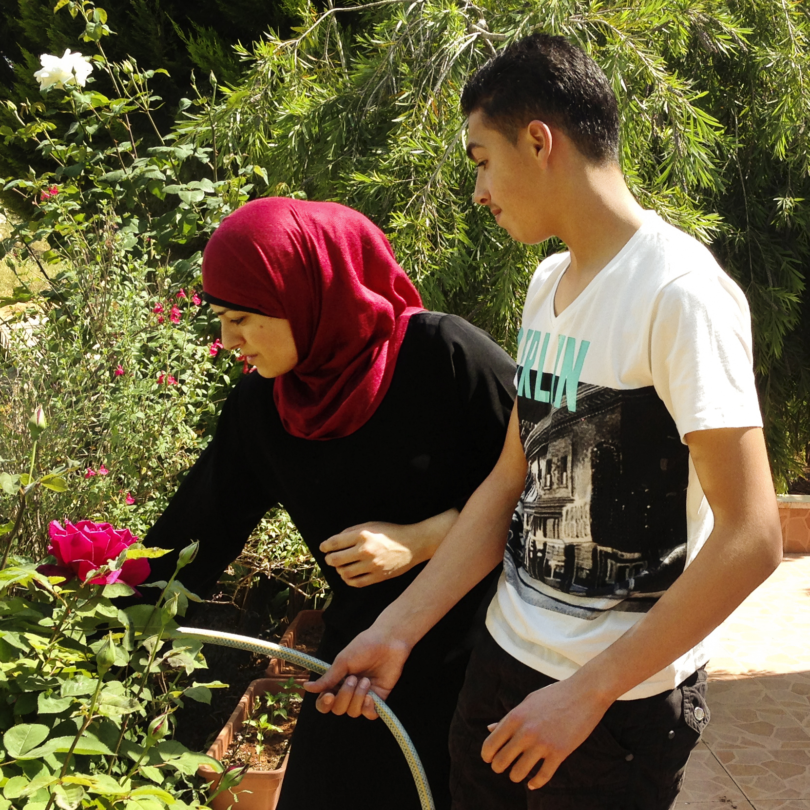 Israeli soldiers came to the home of the Hammed family at 2 a.m. and took 17-year-old Tareq Hammed away. Accused of throwing rocks at Israeli soldiers, he was released after 17 days, the result of a plea bargain and a four-year parole deal. Here, Tareq waters the roses in his family's garden after his release.