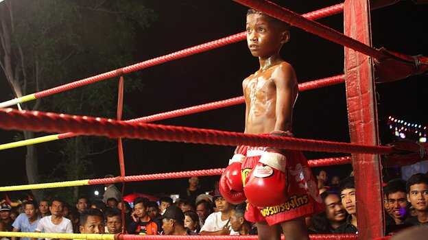 Chai Lorlam is a 9-year-old, 50-pound boxer in northeastern Thailand. The young fighters go through intense training for fights that are held for the benefit of gamblers who often wage large sums on the outcome. Chai is shown here at a recent match.