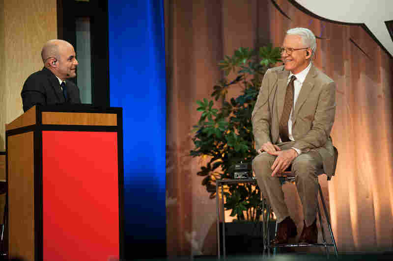 Steve Martin (r) takes questions from Host Peter Sagal about the mundane and dull