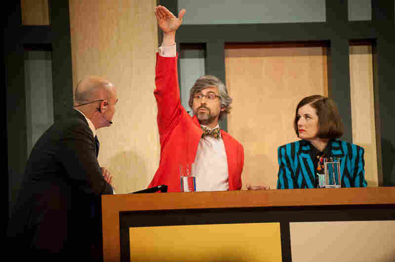 It's possible that Mo Rocca (c) is describing the show's popularity in this photo while chatting with Wait Wait... Don't Tell Me! Host Peter Sagal (l) and fellow panelist Paula Poundstone (r).