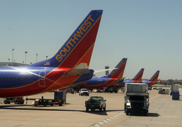 Southwest airline jets are lined up at Long Island MacArthur Islip airport in 2010. Departures at the New York City suburban airport dropped nearly 50 percent between 2007 and 2012, according to an MIT study.
