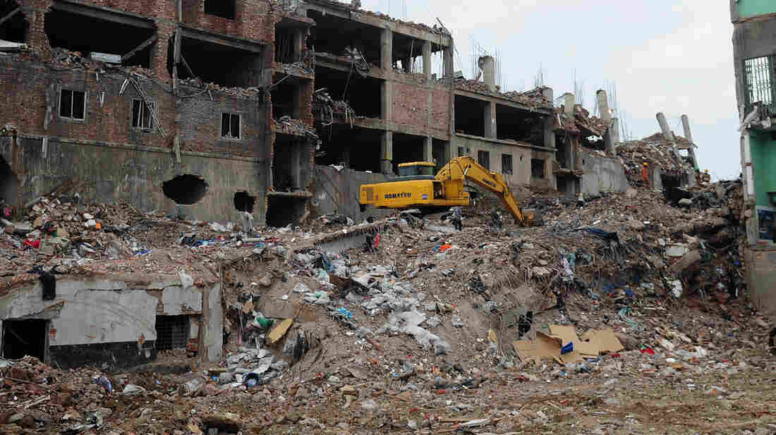 Bangladeshi rescue and army personnel on Wednesday continue recovery operations at the site of the building collapse near Dhaka.