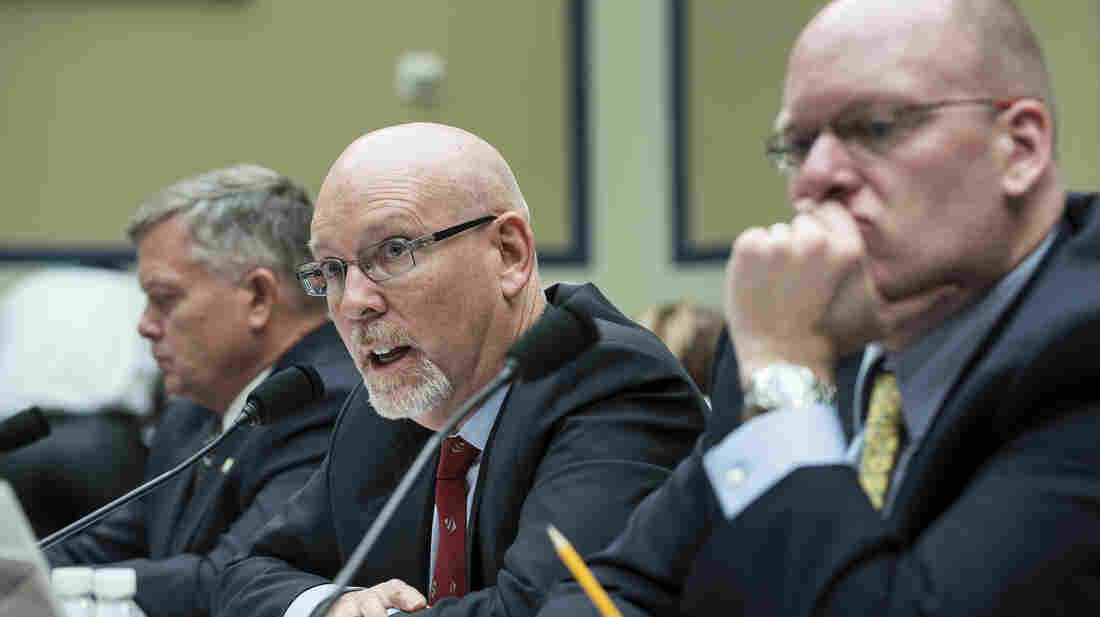 Gregory Hicks testifies Wednesday about the Benghazi attack before the House Committee on Oversight and Government Reform, while Mark Thompson, left, and Eric Nordstrom, listen.