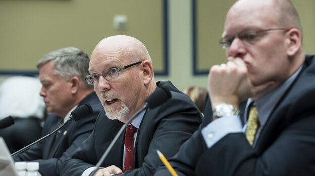 Gregory Hicks testifies Wednesday about the Benghazi attack before the House Committee on Oversight and Government Reform, while Mark Thompson, left, and Eric Nordstrom, listen. (AFP/Getty Images)