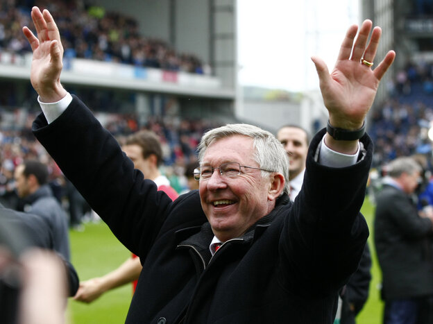 Manchester United manager Alex Ferguson celebrates after his team wins the English Premier League at Blackburn, England, on May