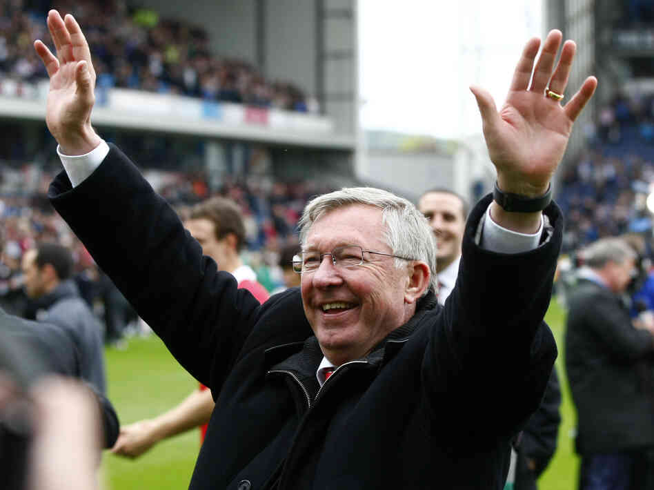 Manchester United manager Alex Ferguson celebrates after his team wins the English Premier League at Blackburn, England, on May 14, 2011