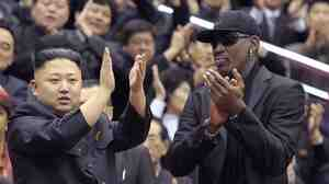 Dennis Rodman, in black hat and shades, with North Korean leader Kim Jong Un at a Feb. 28 basketball game in Pyongyang.