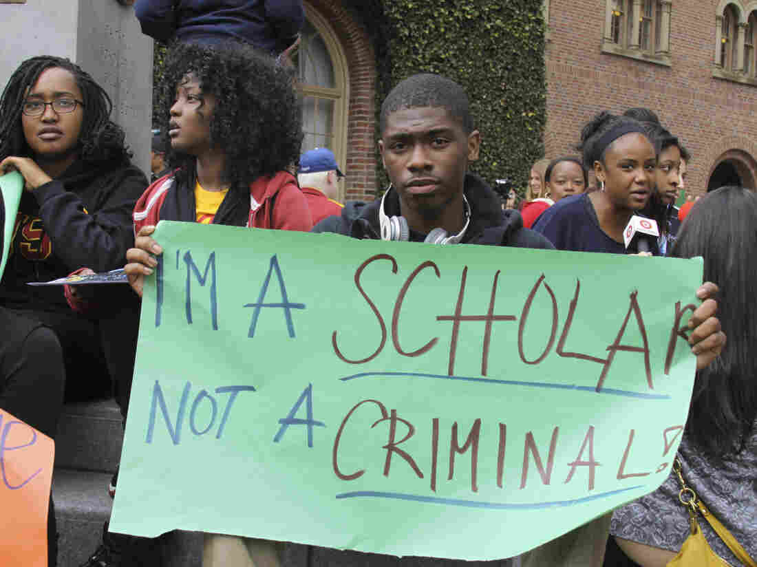 Mark Jones, a USC freshman, protests on Monday.