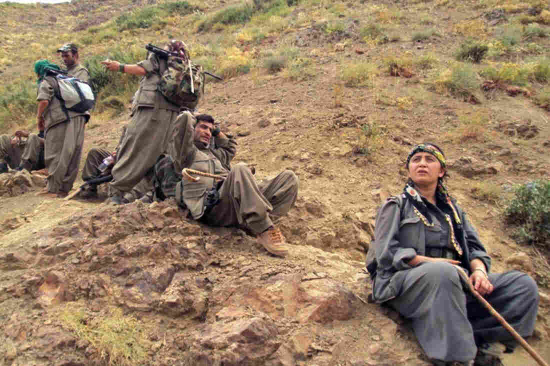 Rebels of the Kurdistan Workers Party, or PKK, begin to move out of Turkey to bases in northern Iraq, a key stage in the peace process with the Turkish government. Here, PKK fighters are shown near the Turkish border with Iraq on May 7.