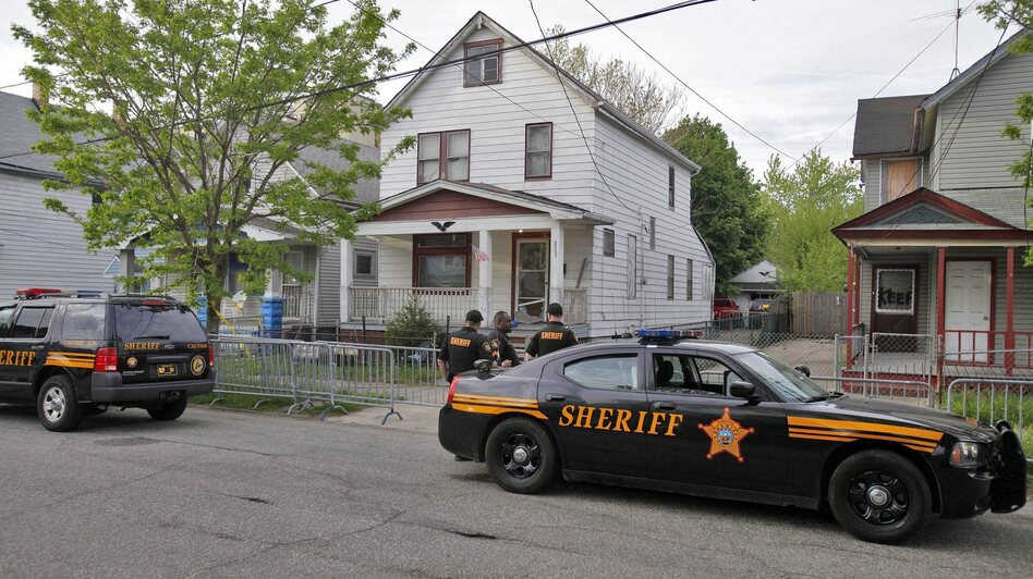 What happened here? The home on Seymour Avenue in Cleveland where three young women who had been missing for about a decade, as well as a child, were rescued on Monday. (EPA /LANDOV)