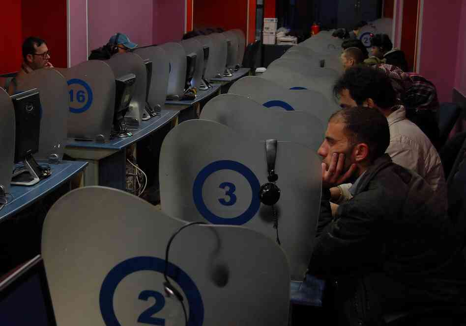 Syrians check e-mails, chat and connect to their Facebook accounts in 2011 at an Internet cafe in Damascus.