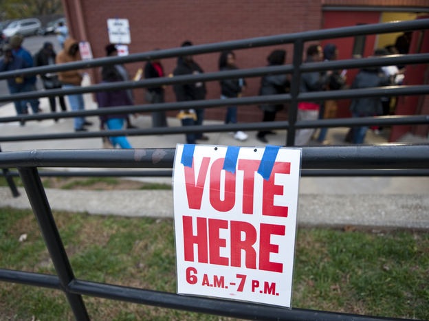 Voters wait in line to cast their ballots at Cleveland Avenue Baptist Church in Kansas City, Mo., on Nov. 6, 2012.