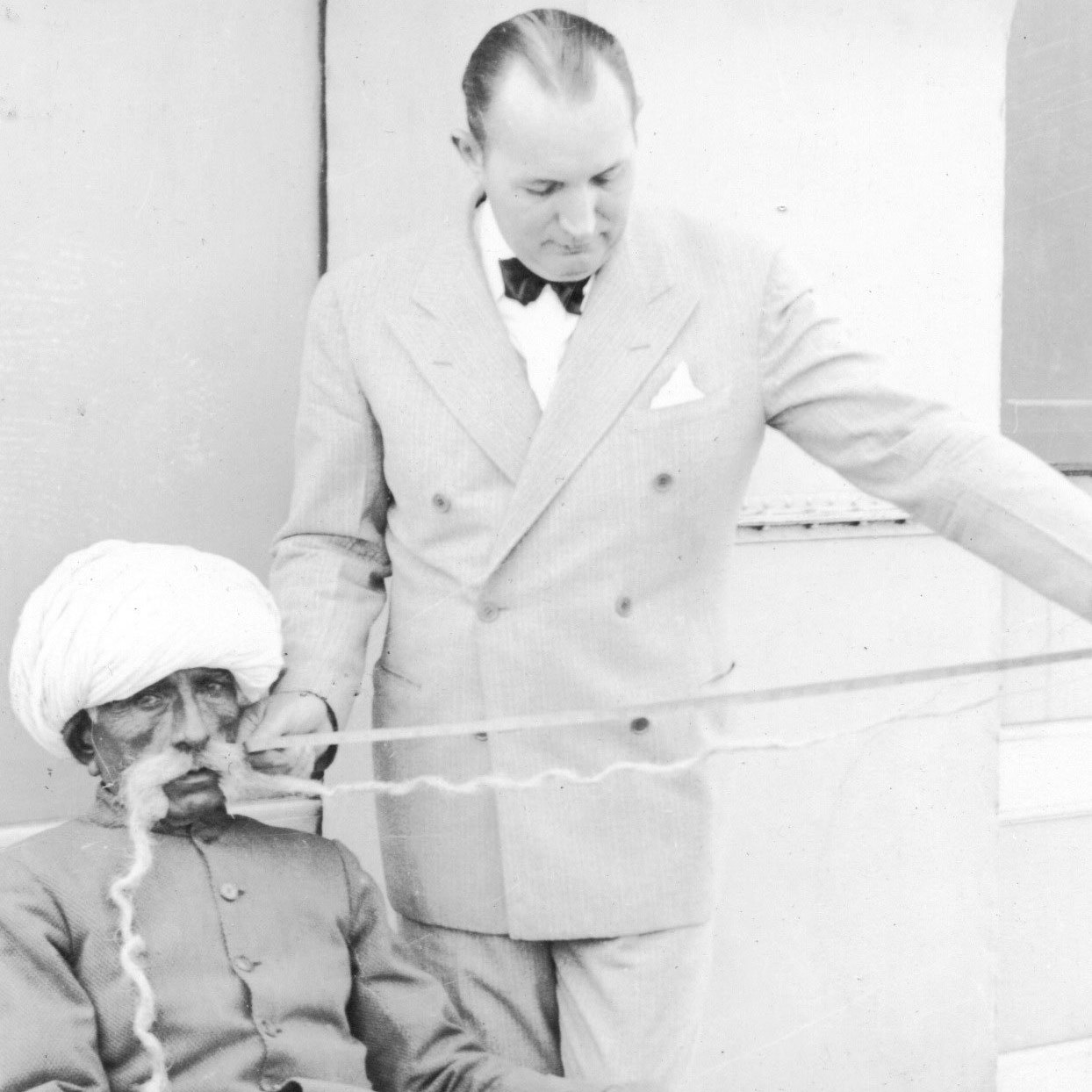 Ripley poses with Arjan Desur Dangar, one of the performers at Ripley's Odditorium exhibition at the 1933 Chicago World's Fair
