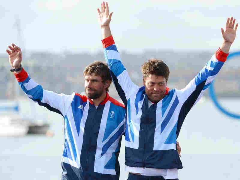Andrew 'Bart' Simpson stands to the left of fellow sailor Iain Percy at the London 2012 Olympic Games.