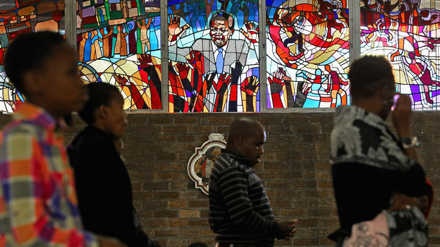Congregants pray in front of a stained-glass window depicting South African statesman Nelson Mandela during Easter services at Regina Mundi Catholic Church in the Soweto of Johannesburg, South Africa, March 3. The church held prayers for Mandela, 94, who was in the hospital at the time. (Getty Images)