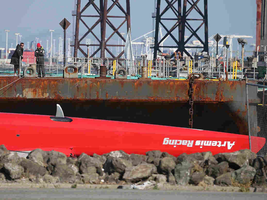 An upside-down hull of the Artemis Racing AC72 catamaran after being towed in to Treasure Island on Thursday.