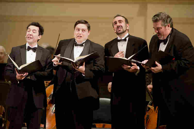 A barbershop-style quartet of singers — from left tenors Jorge Garza and Carl Moe, with baritones Anton Belov and Richard Zeller — played the collective role of Anna's family in Kurt Weill's Seven Deadly Sins.