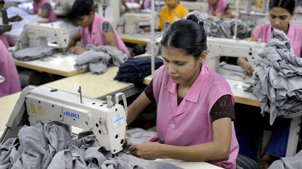 Garment workers sew T-shirts at a factory in Dhaka, Bangladesh, in 2009. Bangladesh, the world's second-largest clothing exporter, has lured clothing makers through a combination of low wages and light regulation. (AFP/Getty Images)