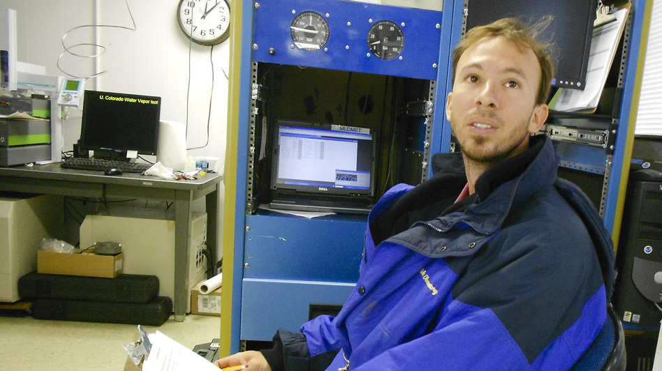"Aidan Colton is a research scientist at the Mauna Loa Observatory. Here in the ""carbon cycle room,"" he measures the amount of carbon dioxide, methane and carbon monoxide in air from intake ports at the top of a 120-foot tower outside the lab. (NPR)"