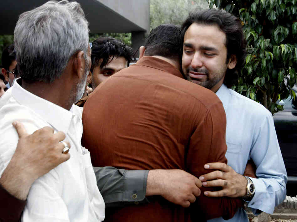 Musa Gilani (right) is comforted on Thursday after his brother, Ali Haider Gilani, was kidnapped at an election ral